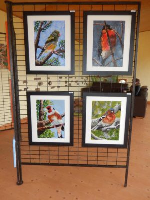 Four framed paintings of finches