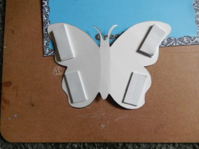 Butterfly wings raised with foam tape
